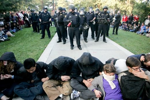 Lt. John Pike leads SWAT team on UC Davis campus just before he pepper sprayed peaceful students. From (http://occupycolleges.org/2011/11/21/video-police-pepper-spray-uc-davis-student-protesters/).